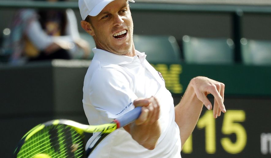 FILE - In this July 2, 2016, file photo, Sam Querrey, of the U.S., returns to Novak Djokovic, of Serbia, during their men's singles match on day six of the Wimbledon Tennis Championships in London. The guy who defeated Djokovic at Wimbledon is ready to get back to playing tennis. Querrey took some time off and now hopes to build off the Djokovic victory this week in Washington and at future events this summer. (AP Photo/Alastair Grant, File)