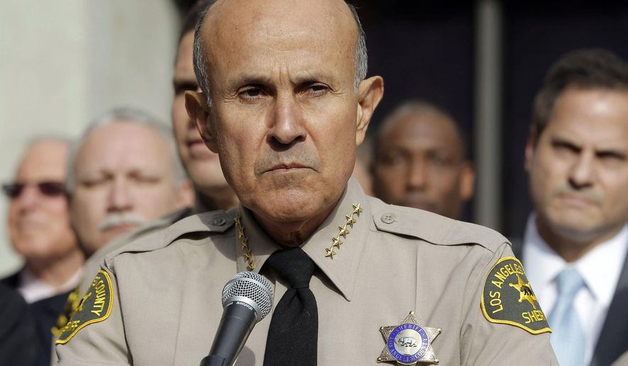 FILE - In this Jan. 7, 2014, file photo, Los Angeles County Sheriff Lee Baca announces his retirement at Sheriff's Headquarters Bureau in Monterey Park, Calif. Baca is set to be sentenced in federal court Monday, July 18, 2016, for his role in a corruption probe that ensnared nearly two dozen members of his staff. (AP Photo/Nick Ut, File)
