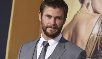 """In this April 11, 2016, file photo, Chris Hemsworth arrives at the LA Premiere of """"The Huntsman: Winter's War"""" at the Regency Village Theatre in Los Angeles. (Photo by Jordan Strauss/Invision/AP, File)"""
