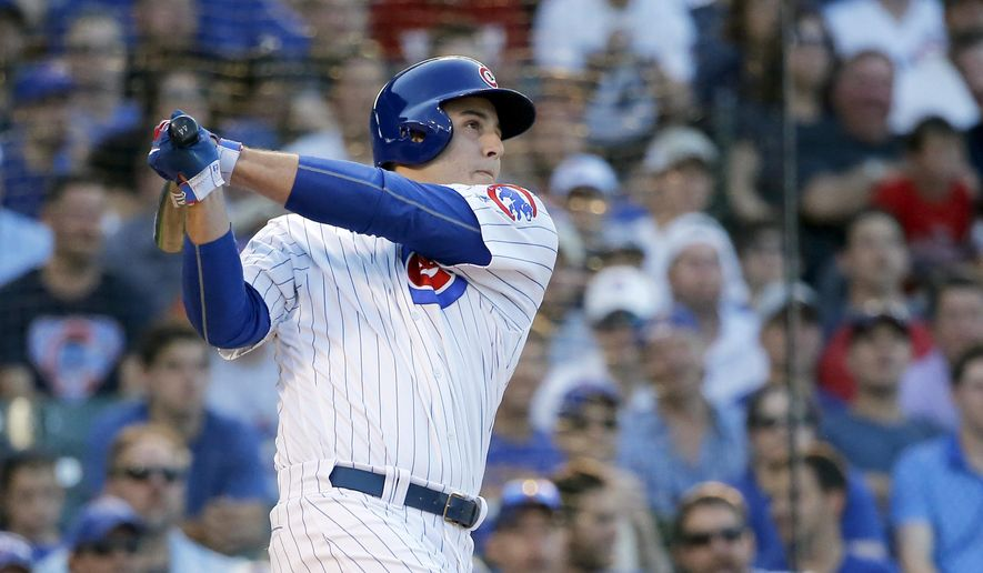 Chicago Cubs' Anthony Rizzo watches his three-run home run off New York Mets' Steven Matz during the third inning of a baseball game Monday, July 18, 2016, in Chicago. Kris Bryant and Javier Baez also scored on the play. (AP Photo/Charles Rex Arbogast)