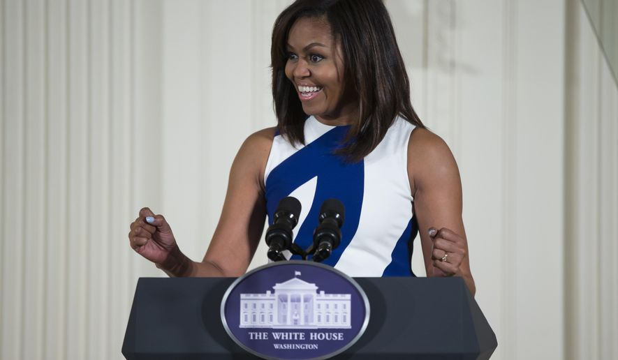 "FILE- In this June 1, 2016 file photo, first lady Michelle Obama speaks in the East Room of the White House in Washington. Michelle Obama's ""Carpool Karaoke"" joyride with James Corden will air Wednesday, July 20, on the late-night host's CBS show. The first lady and Corden sing ""This Is For My Girls,"" described as a ""girl power anthem"" intended to promote full access to education worldwide. (AP Photo/Evan Vucci, File)"