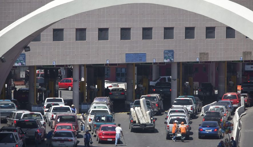 This June 1, 2009 file photo shows vehicles waiting to enter the U.S. through The Dennis DeConcini Port of Entry in downtown Nogales, Ariz. Authorities fear a drainage tunnel that sits underneath the U.S.-Mexico port of entry could collapse any minute, potentially sending cars underground or shuttering the busy crossing in Nogales, Ariz. (Mark Henle/The Arizona Republic via AP, File)