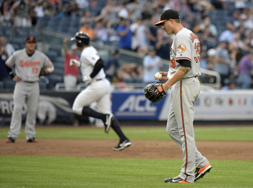 Baltimore Orioles pitcher Kevin Gausman, right, reacts as New York Yankees' Alex Rodriguez rounds the bases with a home run during the second inning of a baseball game Monday, July 18, 2016, at Yankee Stadium in New York. (AP Photo/Bill Kostroun)