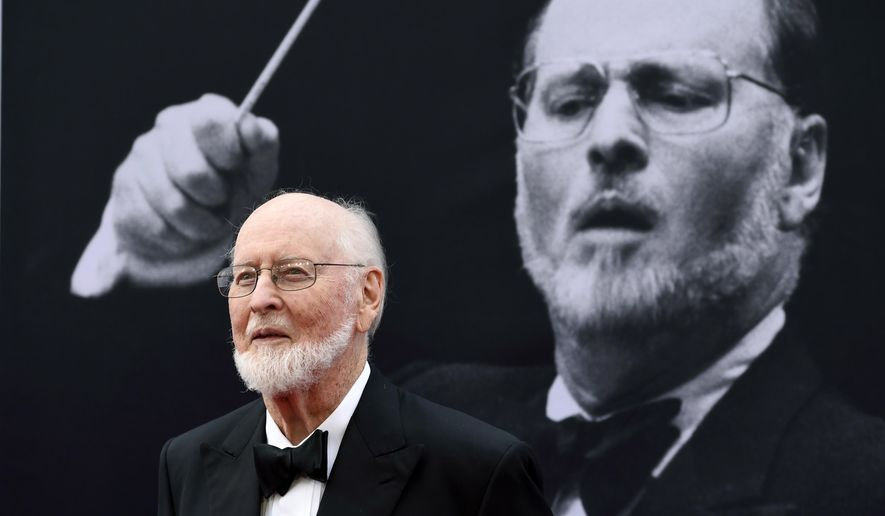 """FILE - In this June 9, 2016, file photo, composer John Williams poses on the red carpet at the 2016 AFI Life Achievement Award Gala Tribute to John Williams at the Dolby Theatre in Los Angeles. In a YouTube video posted July 16, 2016, Williams greets two fans who played the theme from """"Star Wars"""" on the sidewalk in front of his Los Angeles home. (Photo by Chris Pizzello/Invision/AP, File)"""