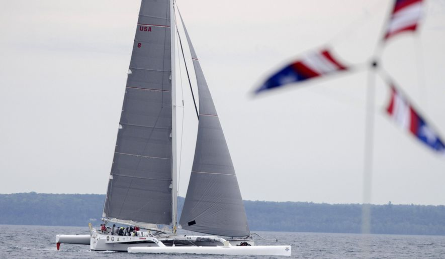 Sailboat Arete crosses the finish line Sunday, July 17, 2016, breaking the record for the first boat to the island for the Cove Island course in the Port Huron-to-Mackinac Island sailboat race.  (Mark R. Rummel /The Times Herald via AP)