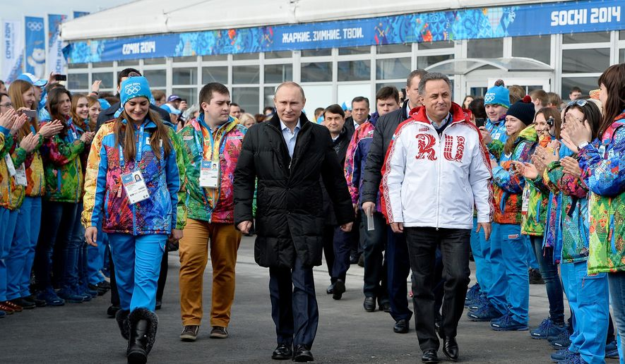 FILE - In this Feb. 5, 2014 file photo Russian President Vladimir Putin, center, visits the Olympic Athletes Village in Coastal Cluster ahead of the Sochi 2014 Winter Olympics with Olympic Village Mayor Elena Isinbaeva, left, and Russian Minister of Sport, Tourism and Youth policy Vitaly Mutko in Sochi, Russia. On Monday, July 18, 2016 WADA investigator Richard McLaren confirmed claims of state-run doping in Russia. (Pascal Le Segretain/Pool Photo via AP, file)