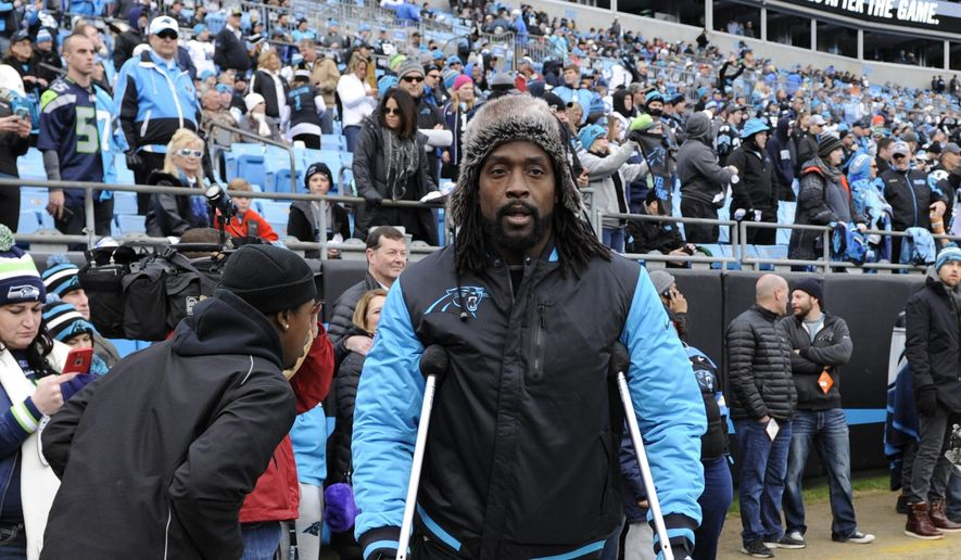 FILE - In this Jan. 17, 2016, file photo, injured Carolina Panthers cornerback Charles Tillman moves on the field before an NFL divisional playoff football game against the Seattle Seahawks in Charlotte, N.C. Tillman is retiring from the NFL after 13 seasons. He started 12 games last season with the Panthers before suffering a season-ending knee injury and missing the team's run to the Super Bowl.  (AP Photo/Mike McCarn, File)