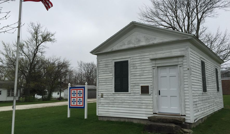 This April 23, 2016 photo shows the Giddings Law Office, a National Historic Landmark and museum in Jefferson, Ohio. The building, which dates to 1823, was dedicated Friday following preservation and restoration work. The building houses a desk and other items belonging to Joshua Giddings, a 19th century Ohio congressman who helped ensure that anti-slavery sentiment was part of the platform for the first Republican Party convention in 1856. (AP Photo/Beth J. Harpaz)
