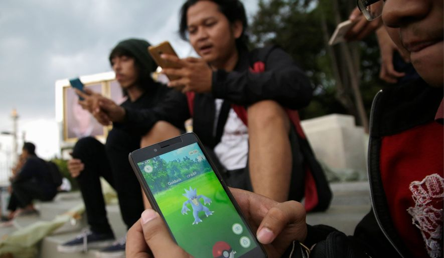 Using a smartphone's GPS, the Pokemon Go app creates a map of the player's surroundings and then taps into the phone's camera to generate a virtual image of a Pokemon on the screen. The more Pokemon a player has, the more power. (Associated Press)