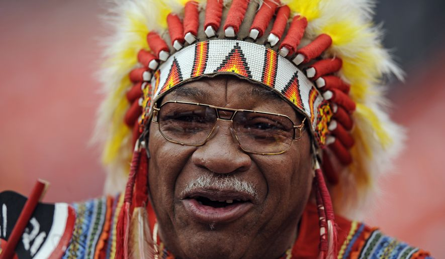 """Washington Redskins fan Zema """"Chief Zee"""" Williams cheers on his team before the NFL football game against the Kansas City Chiefs, Sunday, Oct. 18, 2009 in Landover, Md. (AP Photo/Nick Wass) **FILE**"""