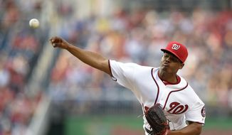 Washington Nationals starting pitcher Reynaldo Lopez throws during the first inning of a baseball game against the Los Angeles Dodgers, Tuesday, July 19, 2016, in Washington. This is Lopez's Major League debut. (AP Photo/Nick Wass) **FILE**