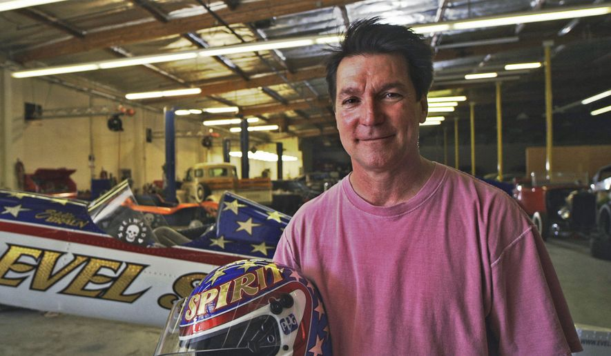 In this July 2016, photo provided by Weiward, Eddie Braun poses for a photo at a storage facility in Chatsworth, Calif. Fueled by the memory of the late daredevil Evel Knievel, Hollywood stuntman Braun plans to strap into a steam-powered rocket cycle on Sept. 17, for his most death-defying role yet. (Weiward via AP)