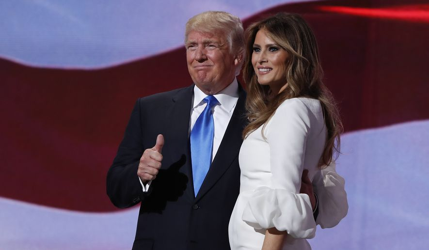 Republican presidential candidate Donald Trump, right, stands with his wife Melania on stage after introducing her during the Republican National Convention, Monday, July 18, 2016, in Cleveland. (AP Photo/Carolyn Kaster)