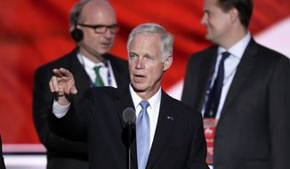 Sen. Ron Johnson, R-Wis., looks over the podium during a sound check before the second day of the Republican National Convention in Cleveland, Tuesday, July 19, 2016. (AP Photo/J. Scott Applewhite)