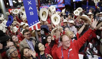 Texas delegates cheer during the second day session of the Republican National Convention in Cleveland, Tuesday, July 19, 2016. (AP Photo/John Locher)