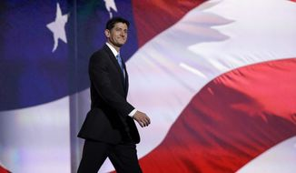 Speaker Paul Ryan of Wisconsin walks to the podium during the second day session of the Republican National Convention in Cleveland, Tuesday, July 19, 2016. (AP Photo/Matt Rourke)