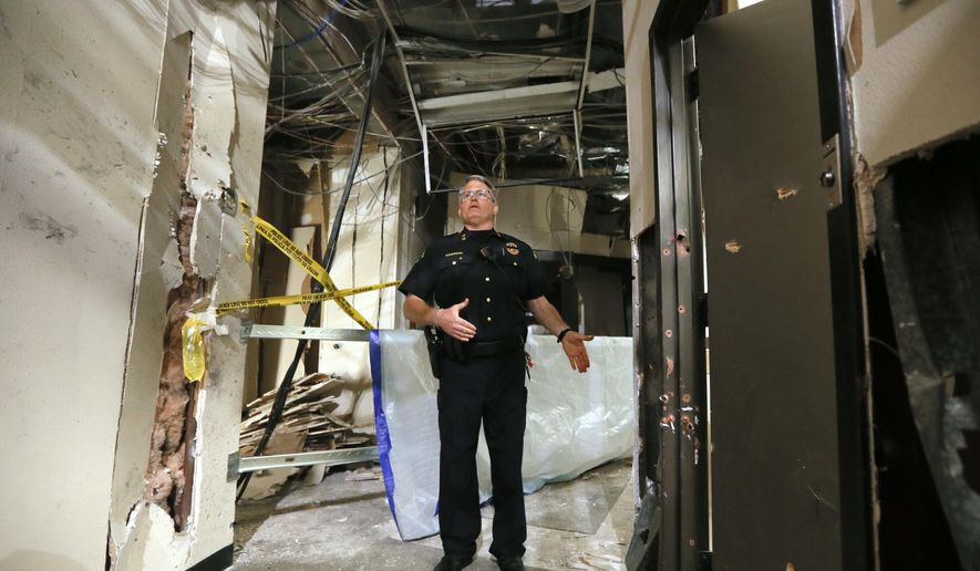 El Centro College Police Chief Joseph Hannigan stands at the end of a hallway as he gives a guided tour of the damage caused by a blast that killed Micah Johnson, Tuesday, July 19, 2016, in Dallas. Johnson killed five officers and wounded several others during a protest earlier this month. (AP Photo/Tony Gutierrez)