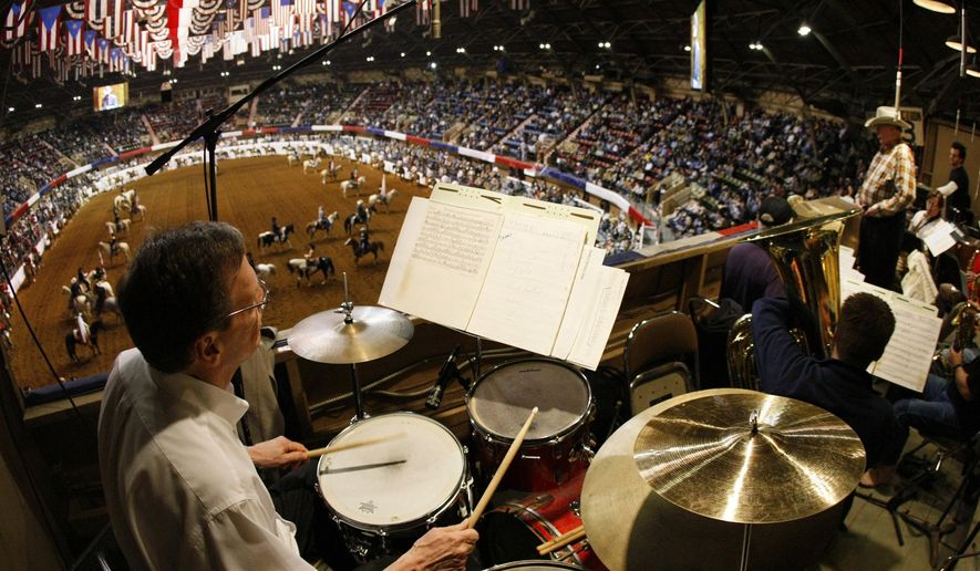 In this Jan. 12, 2008, photo, director Jack Cobb, far right, leads the 21-piece ensemble during the start of the nightly 2008 Fort Worth Stock Show and Rodeo performance at Will Rogers Coliseum in Fort Worth, Texas.  For the first time in nearly 100 years, when the horses and their riders canter into the Will Rogers Memorial Center on Jan. 13 for the beginning of the 2017 Fort Worth Stock Show & Rodeo, there will be no live orchestra to greet them. (Star-Telegram via AP)