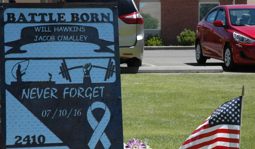 A sign is pictured outside the memorial service for two federal firefighters killed when their fire truck crashed on the way home from wildfire spotting patrol Tuesday, July 19, 2016, in Winnemucca, Nev. Jacob O'Malley, 27, and Will Hawkins, 22, died in the July 10 crash. (Cheryl Upshaw/The Humboldt Sun via AP)