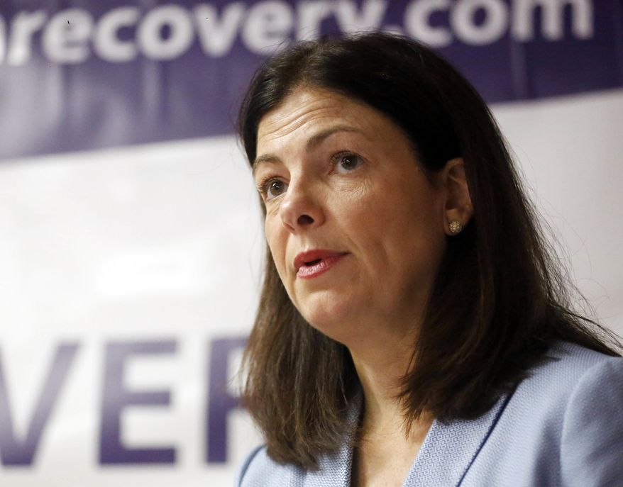 Sen. Kelly Ayotte, R-N.H., speaks Monday, July 18, 2016 at the opening of the HOPE for NH Recovery Center, which opened to help fight New Hampshire's opiate crisis in Claremont, N.H. Ayotte is one of many prominent Republicans skipping the convention. (AP Photo/Jim Cole)