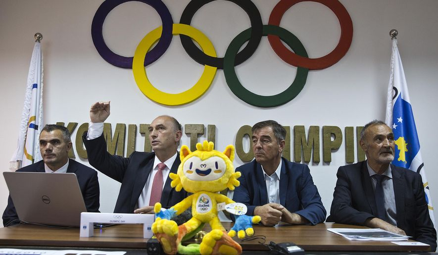 Officials of the Kosovo Olympic Committee announce the names of the 8 Kosovo athletes that will participate in Rio 2016 Olympics during a press conference in capital Pristina, Kosovo on Tuesday, July 19, 2016. Kosovo, will take part at its first-ever Olympics since it declared independence eight years ago. (AP Photo/Visar Kryeziu)