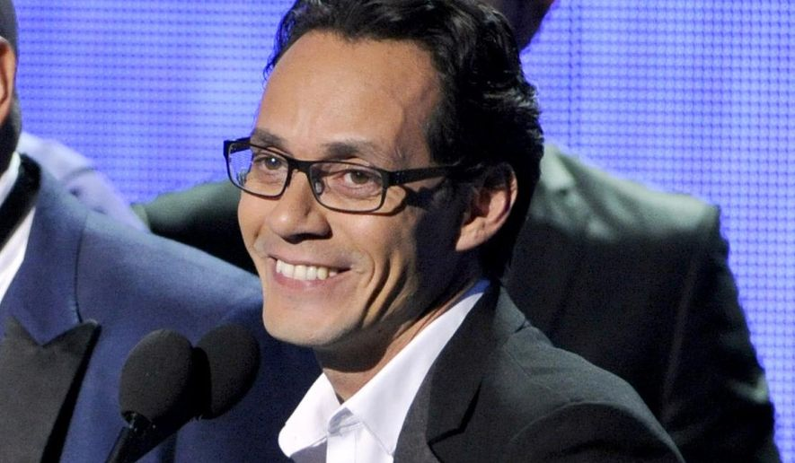 FILE - In this Nov. 20, 2014 file photo, Marc Anthony, winner of the award for best salsa album, speak on stage at the 15th annual Latin Grammy Awards at the MGM Grand Garden Arena in Las Vegas. Marc Anthony has been named 2016 Latin Recording Academy Person of the Year. The academy will honor the five-time Latin Grammy and two-time Grammy winner on Nov. 16 at the MGM Grand Garden Arena in Las Vegas, on the eve of the Latin Grammys. (Photo by Chris Pizzello/Invision/AP, File)