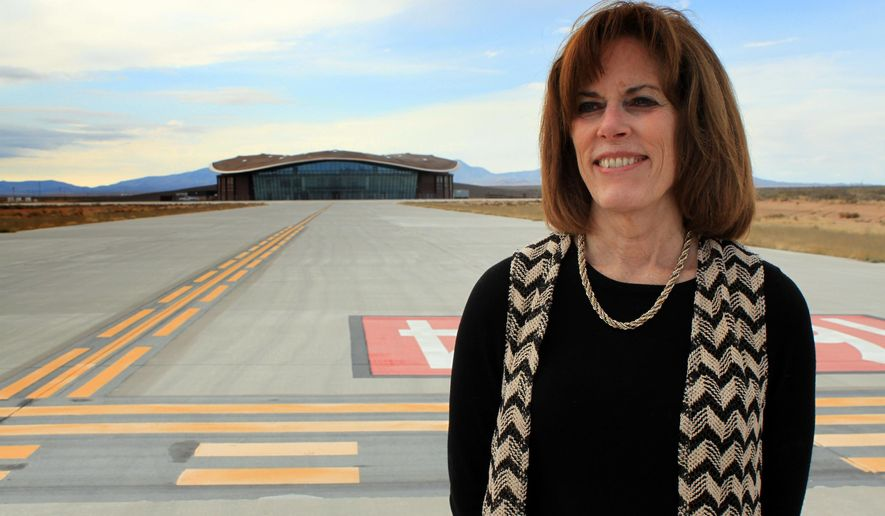 FILE - In this Dec. 9, 2014, file photo, Christine Anderson, executive director of the New Mexico Spaceport Authority, poses for a photo at the end of the taxiway at Spaceport America in Upham, N.M. Anderson is resigning, saying she still believes in the commercial space industry and that Spaceport America has a role to play. Anderson announced her resignation in a memo sent Tuesday, July 19, 2016, to the authority's board of directors and New Mexico Gov. Susana Martinez. (AP Photo/Susan Montoya Bryan, File)