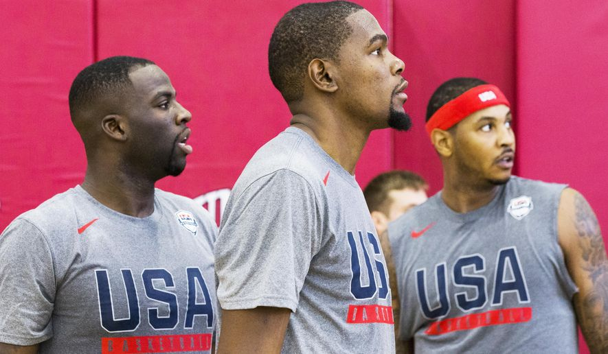 Golden State Warriors teammates Draymond Green, left, and Kevin Durant, middle, watch team drills during Team USA basketball practice in Las Vegas on Monday, July 18, 2016. (Benjamin Hager/Las Vegas Review-Journal via AP)