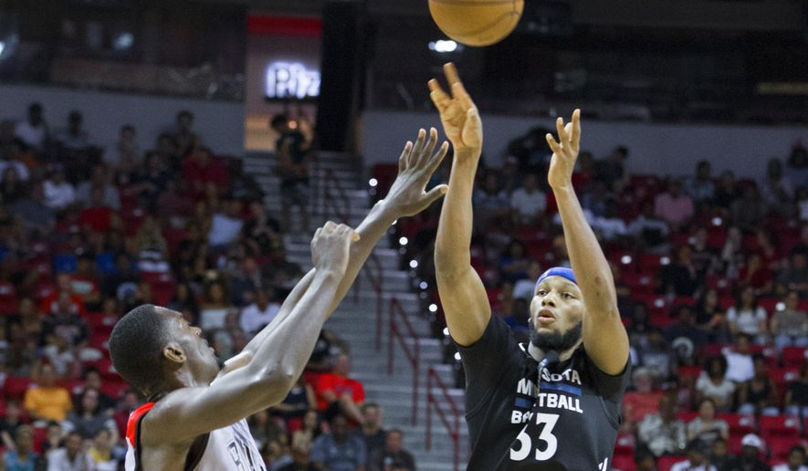 Minnesota Timberwolves forward Adreian Payne (33) shoots over Chicago Bulls forward Bobby Portis (5) during an NBA summer league basketball game in Las Vegas on Monday, July 18, 2016. The Bulls won 84-82 in overtime. (Benjamin Hager/Las Vegas Review-Journal via AP)