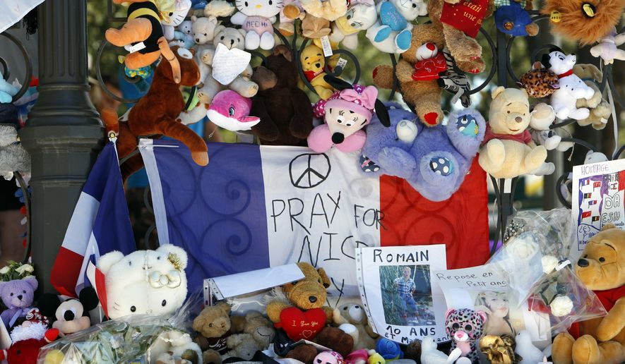 Dolls and teddy bears are placed at a memorial in a gazebo on the Promenade des Anglais in Nice, southern France, Wednesday, July 20, 2016. Joggers, cyclists and sun-seekers are back on Nice's famed Riviera coast, a further sign of normal life returning on the Promenade des Anglais where dozens were killed in last week's Bastille Day truck attack. (AP Photo/Claude Paris)