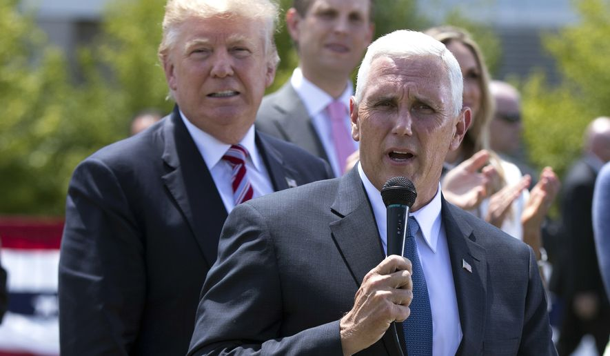 Republican presidential candidate Donald Trump, left, watches as vice presidential candidate Gov. Mike Pence, R-Ind., speaks near the site of the Republican National Convention, Wednesday, July 20, 2016, in Cleveland. (AP Photo/Evan Vucci)