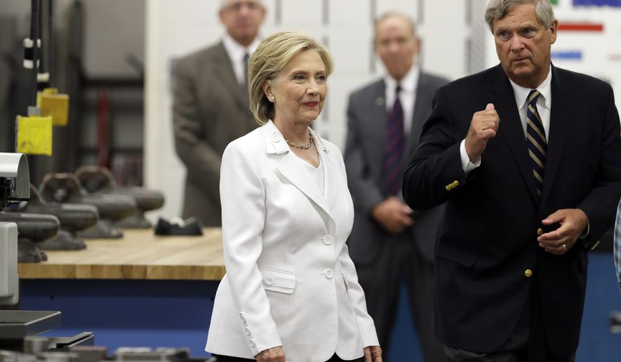 FILE - In this Aug. 26, 2015, file photo, Democratic presidential candidate Hillary Clinton and Agriculture Secretary Tom Vilsack tour the Tool and Die Lab at the Des Moines Area Community College in Ankeny, Iowa. Vilsack is possibly being considered as a potential running mate for Clinton. (AP Photo/Charlie Neibergall, File)