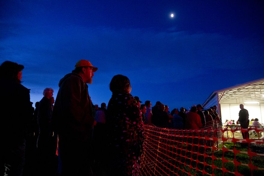 """Hundreds of people line up at dawn with their numbered tickets to attend the Remote Area Medical (RAM) clinic in Smyth County, Va., on April 29, 2016. RAM provides free medical care to people who do not have health insurance in several states across the country. Specializing in free dental, vision and medical care in isolated and poverty-stricken communities, the group sets up mobile medical centers and is having their 800th such event this year. """"I've done foreign volunteer missions before, but never domestic"""" says volunteer dentist Mark Copas. """"These cases are just as bad as what I've seen in third world countries."""" (Associated Press)"""