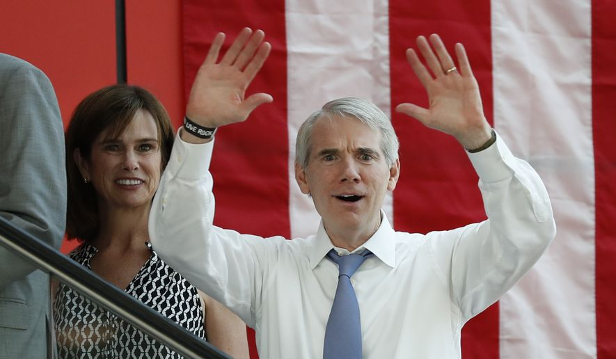 Sen. Rob Portman, R-Ohio, right, arrives with his wife arrive at the The Rock and Roll Hall of Fame and Museum on Tuesday, July 19, 2016, in Cleveland, during the second day of the Republican convention. (AP Photo/Alex Brandon)