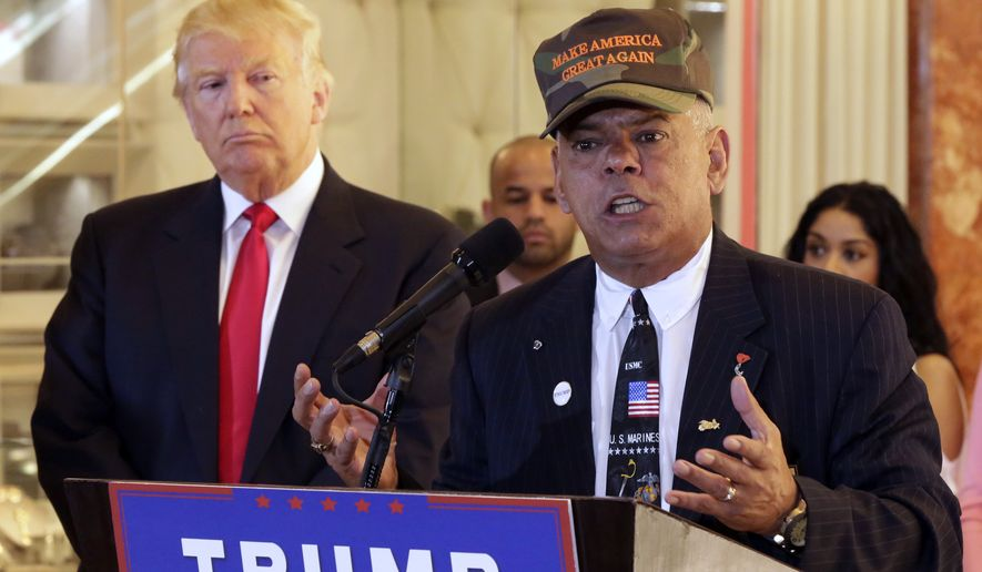 """In this May 31, 2016, file photo, Republican presidential candidate Donald Trump listens at left as Al Baldasaro, a New Hampshire state representative, speaks during a news conference in New York. Baldasaro said on a Boston radio program on July 19 that Hillary Clinton should be """"put in the firing line and shot for treason,"""" over the Benghazi, Libya, attacks that killed four Americans. (AP Photo/Richard Drew, File)"""