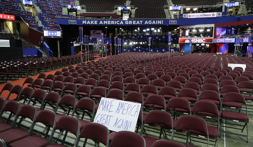 A sign sits on empty chairs before the third day session of the GOP 2016 Convention, Wednesday, July 20, 2016, in Cleveland. (AP Photo/John Locher)