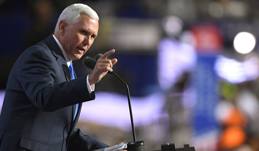 """""""Democrats are about to anoint someone who represents everything this country is tired of,"""" Indiana Gov. Mike Pence told the convention crowd. (Associated Press)"""