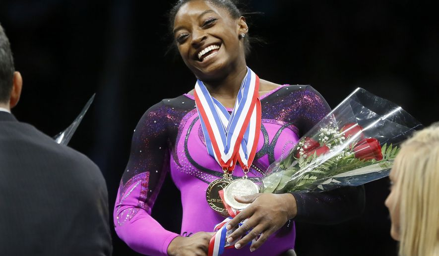 FILE - In this Aug. 23, 2014, file photo, Simone Biles smiles after getting her gold medal at the gymnastics U.S. Championships in Pittsburgh. Theres money to be made if you end up standing atop the podium at the Olympics with The Star Spangled Banner playing and your sports most coveted prize draped over your neck.  (AP Photo/Keith Srakocic, File)