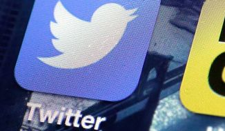 A Twitter app is seen on an iPhone screen. (Associated Press)