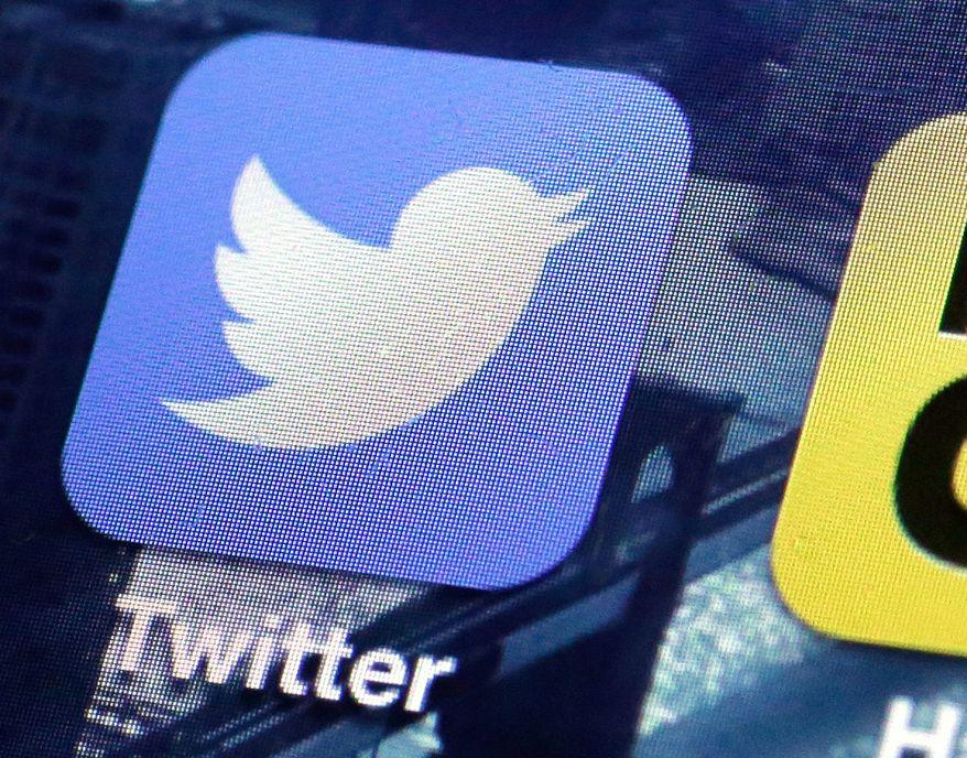 A Twitter app is seen on an iPhone screen. (Associated Press)