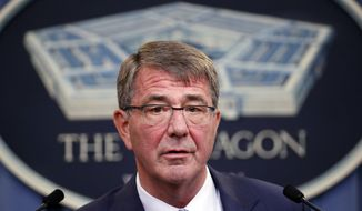 FILE - In this June 30, 2016, file photo, Defense Secretary Ash Carter speaks during a news conference at the Pentagon. Defense and foreign ministers from more than 30 nations are gathering in Washington to plan the next steps in the fight against the Islamic State and to determine what more they can do as the fights for key cities in Iraq and Syria move forward. Carter will meet with his counterparts Wednesday, July 20, to discuss how they can accelerate the campaign and build on the momentum, particularly in Iraq. (AP Photo/Alex Brandon, File)