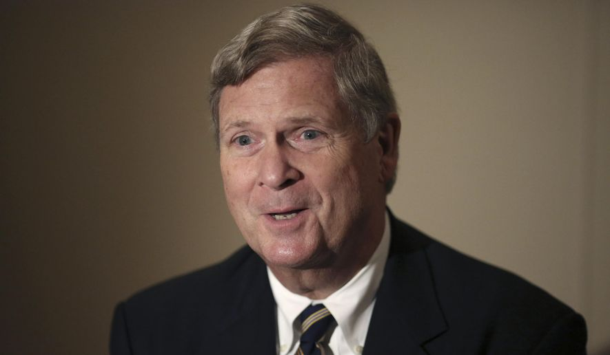 In this Nov. 20, 2015, file photo, then-U.S. Agriculture Secretary Tom Vilsack speaks during an interview with The Associated Press in Tokyo. (AP Photo/Eugene Hoshiko, File)
