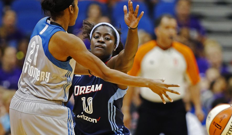 Minnesota Lynx's Renee Montgomery (21) dishes off a pass as Atlanta Dream's Matee Ajavon defends during a WNBA basketball game at Target Center, Wednesday, July 20, 2016, in Minnesota. (Richard Tsong-taatarii/Star Tribune via AP)
