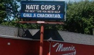 """A billboard reading, """"Hate Cops? the next time you need help call a crackhead"""" was visible for at least a few hours Saturday in Muncie, Indiana, according to the Muncie Star Press on Wednesday. (Courtesy of WTHR.com via Megan Thomas)"""