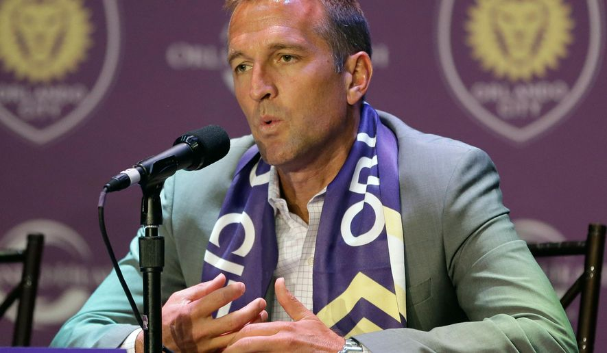 New Orlando City MLS soccer team head coach Jason Kries, answers questions at a news conference, Wednesday, July 20, 2016, in Orlando, Fla. (AP Photo/John Raoux)-