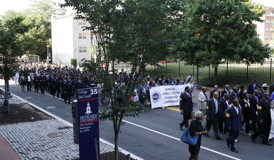 The National Organization of Black Law Enforcement Executives (NOBLE) honored fallen police officers with a Memorial March at Howard University, Wednesday, July 20, 2016, in Washington. The march included over 1200 participants, including police officers, civil rights leaders and supporters from across the country. (AP Photo/Paul Holston)