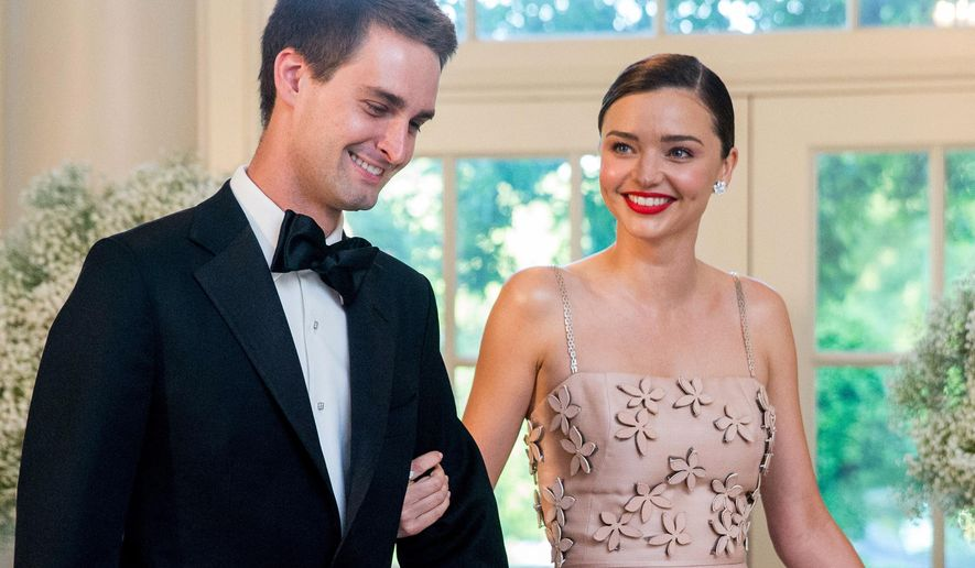 FILE - In this May 13, 2016 file photo, model Miranda Kerr, right, and her boyfriend, Snapchat CEO Evan Spiegel, arrive for a state dinner for Nordic leaders at the White House in Washington. Kerr announced on her Instagram account, Wednesday, July 20, that the couple are engaged. This will be the second marriage for Kerr, who was previously married to actor Orlando Bloom. They have a 5-year-old son together named Flynn. Spiegel, 26, has never been married. (AP Photo/Andrew Harnik, File)