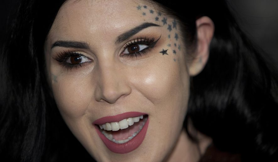 In this Oct. 7, 2015, file photo, tattoo artist Kat Von D speaks with the media during the presentation of her new line of makeup in Madrid. (AP Photo/Abraham Caro Marin, File)