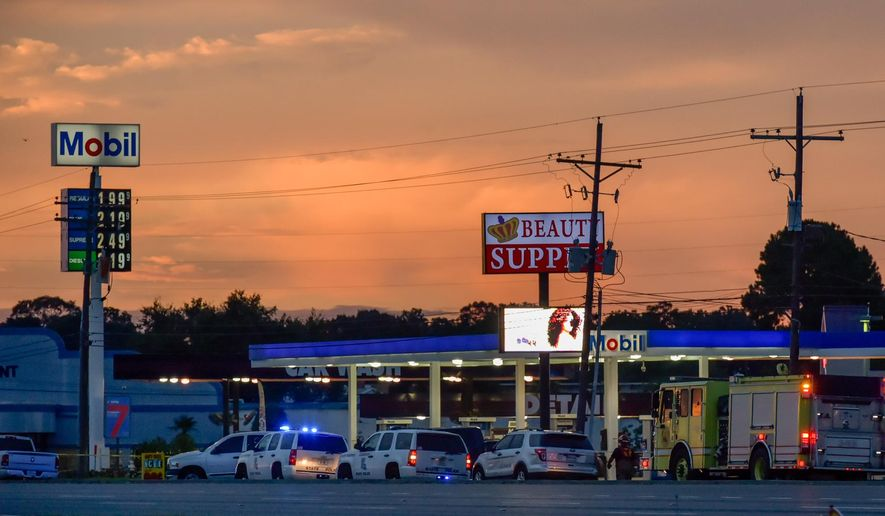 In this Sunday, July 17, 2016, file photo, Baton Rouge Police investigate the scene in Baton Rouge, La., where several law enforcement officers were killed and wounded. (Scott Clause/The Daily Advertiser via AP, File)