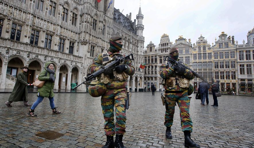 FILE - In this Nov. 24, 2015 file photo, police officers patrol the Grand Place in central Brussels. Between terror attacks, Zika and mass shootings, there's lots of bad news about popular destinations around the world. Where does that leave travelers who may want to stay home instead of going through with a trip? It depends on the circumstances. Cancel-for-any-reason insurance is expensive to buy but provides refunds if you change your mind about a trip. Standard trip insurance may also cover cancellations to a destination hit by terrorism for a period of days following an attack. (AP Photo/Michael Probst, File)